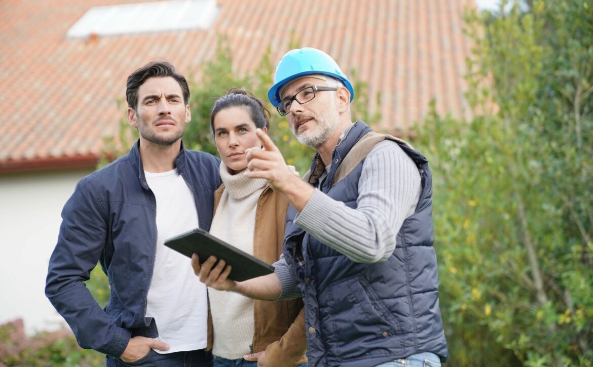 Builder going through outdoor plans with homeowners